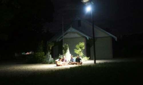 Kids Playing under Street Lamp