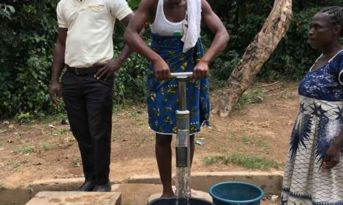 A villager pumping clean water